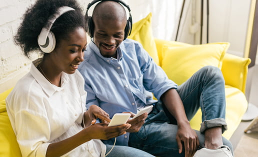 couple with headphones listening to music